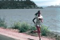 17081-a-woman-running-along-a-lake-shore-pv