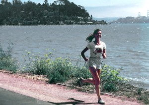 17081-a-woman-running-along-a-lake-shore-pv